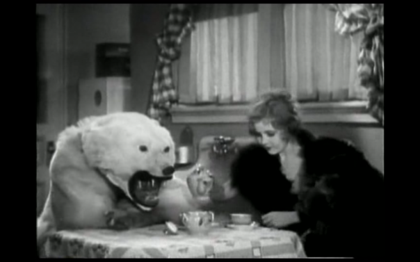 A moment of escape under a bear rug but within the social bounds permitted by tea