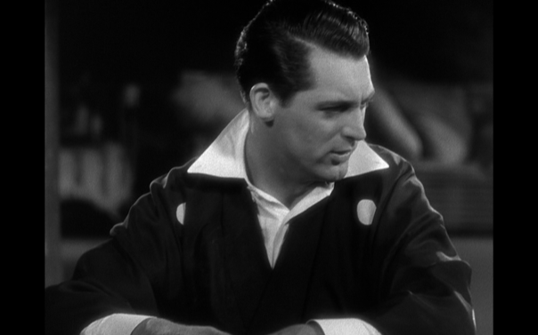 Cary Grant becoming 'Cary Grant' in a Noel Coward-esque wardrobe.
